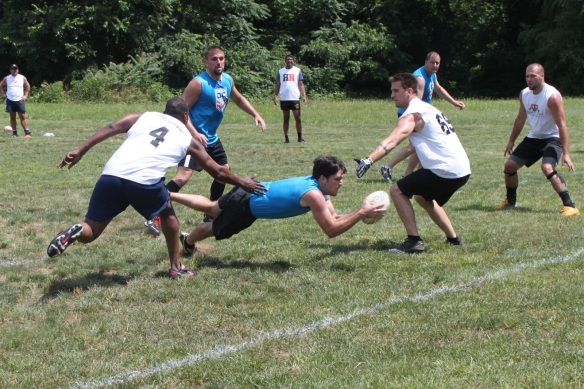 John's famous (and unfortunately unsuccessful) dive at the try line during a tournament match against Columbia Touch